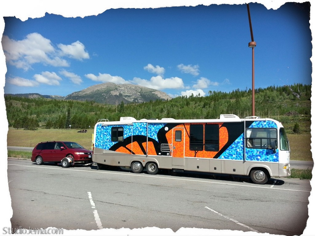 Monarch butterfly RV with orange and blue