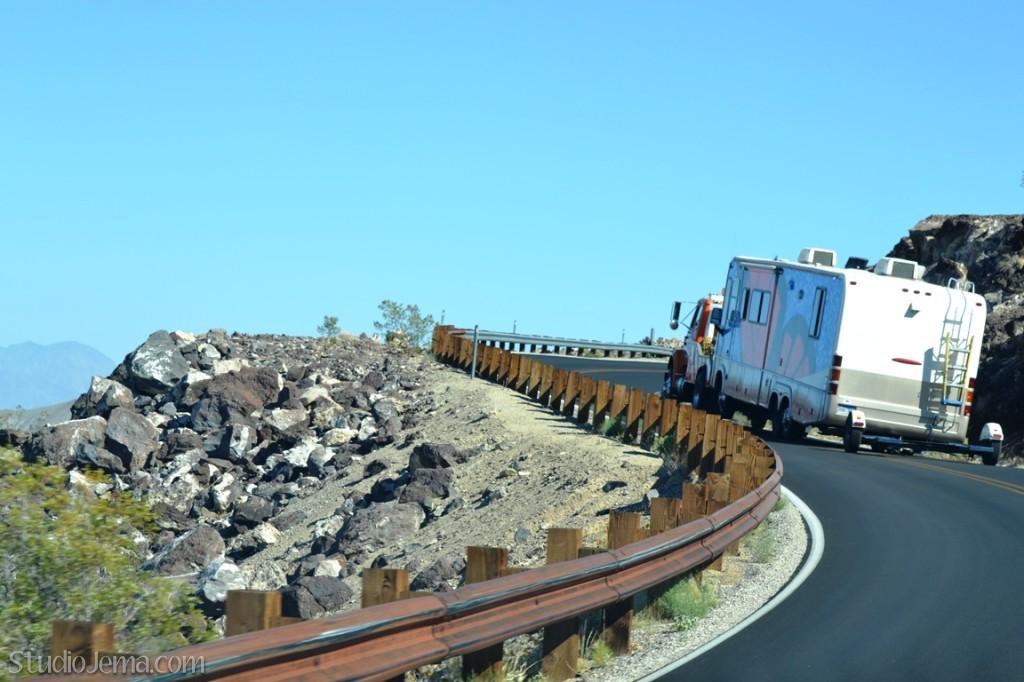 rv being towed on mountain ridge