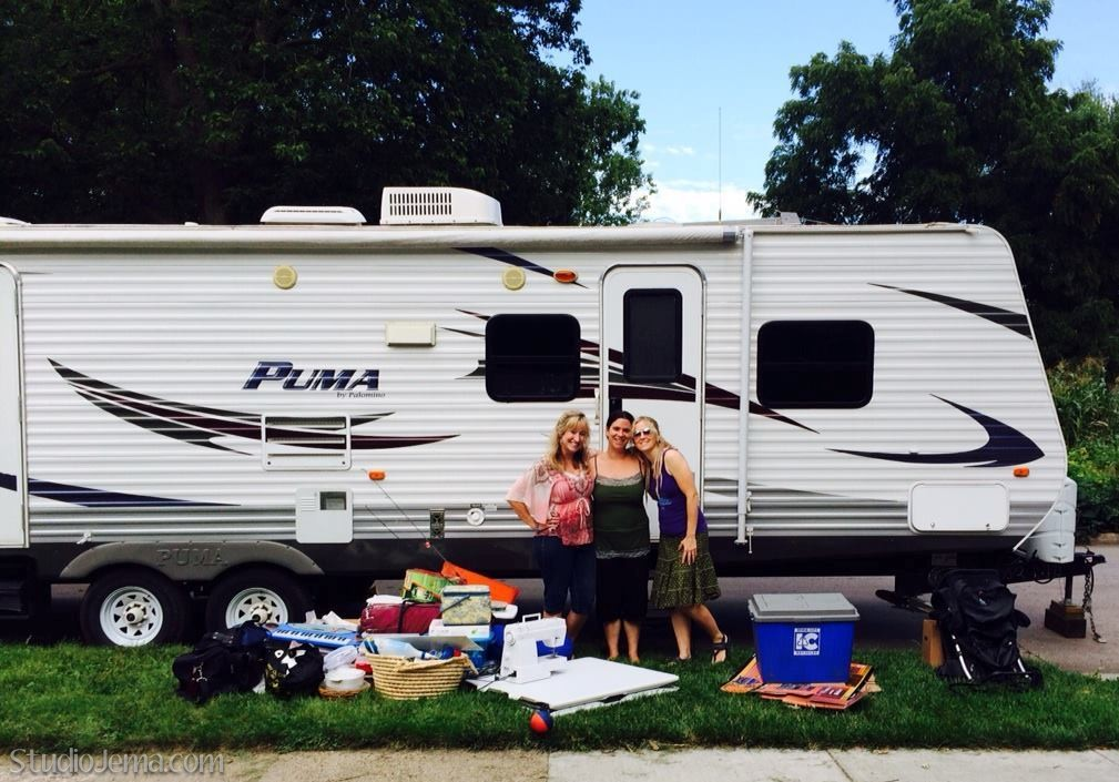 White Travel Trailer with three girlfriends.