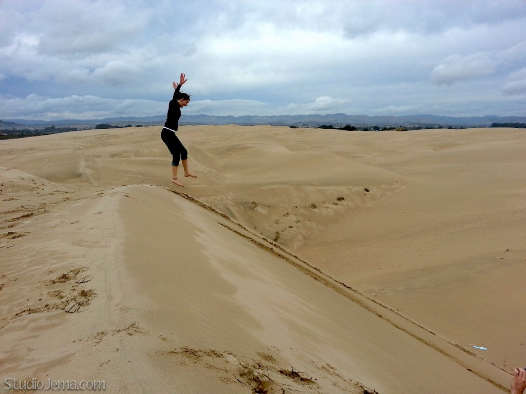Grace jumping off of the dunes at Oceano Dunes, California.