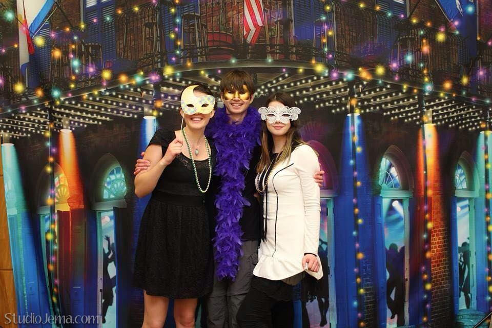 Three kids dressed up for Mardi Gras homeschool dance in Anaheim, California.